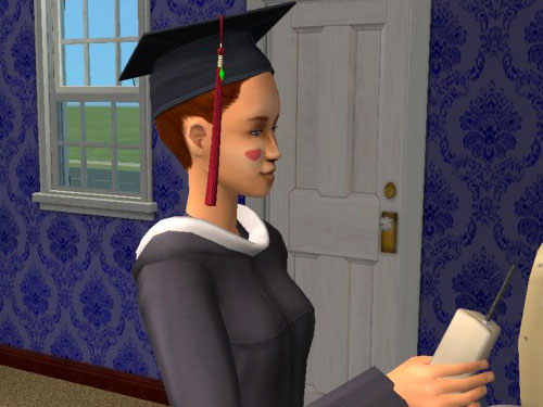 Candice in cap and gown, on the phone.