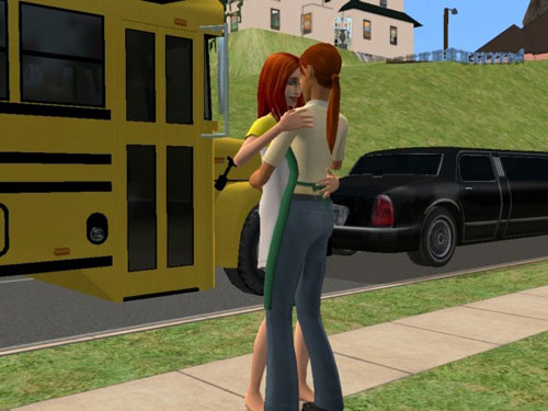 Nicole and Dawn slow dancing by the school bus