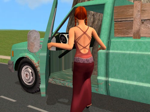The gardener, still in her gown, returns to her truck