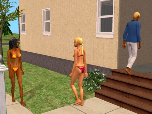 Gabriel and some attractive young women in swim suits, outside the dorm