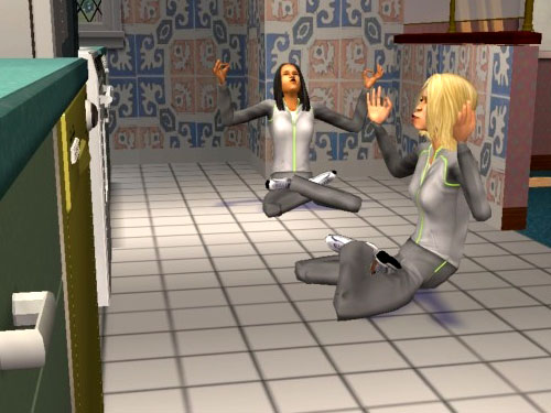 The ladies meditating comically in the kitchen